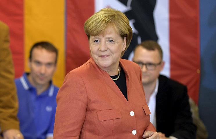 Экзитпол: блок Меркель побеждает на выборах в Бундестаг
