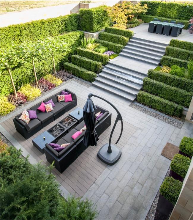 Озеленение самшитом и благоустройство загородного участка со ступенями на разных уровнях