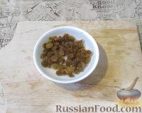 Фото приготовления рецепта: Пряный рис с изюмом и миндалем - шаг №7
