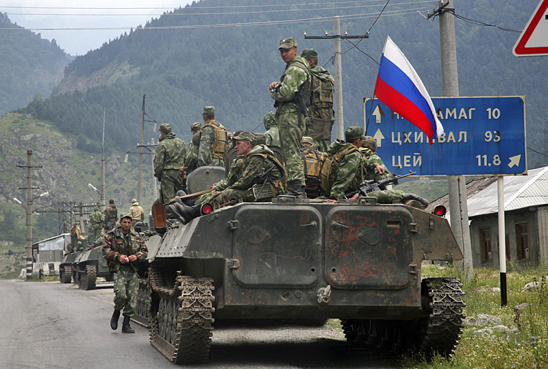 A column of Russian armored vehicles, heading towards the breakaway Georgian province of South Ossetia, are seen in North Ossetia, Russia, Friday, Aug. 8, 2008. A surprise military offensive by Georgia, a staunch U.S. ally, to retake the breakaway province of South Ossetia reportedly killed hundreds of people Friday, triggering a ferocious counterattack from Russia that threatened to plunge the region into full-scale war. (AP Photo/Musa Sadulayev)