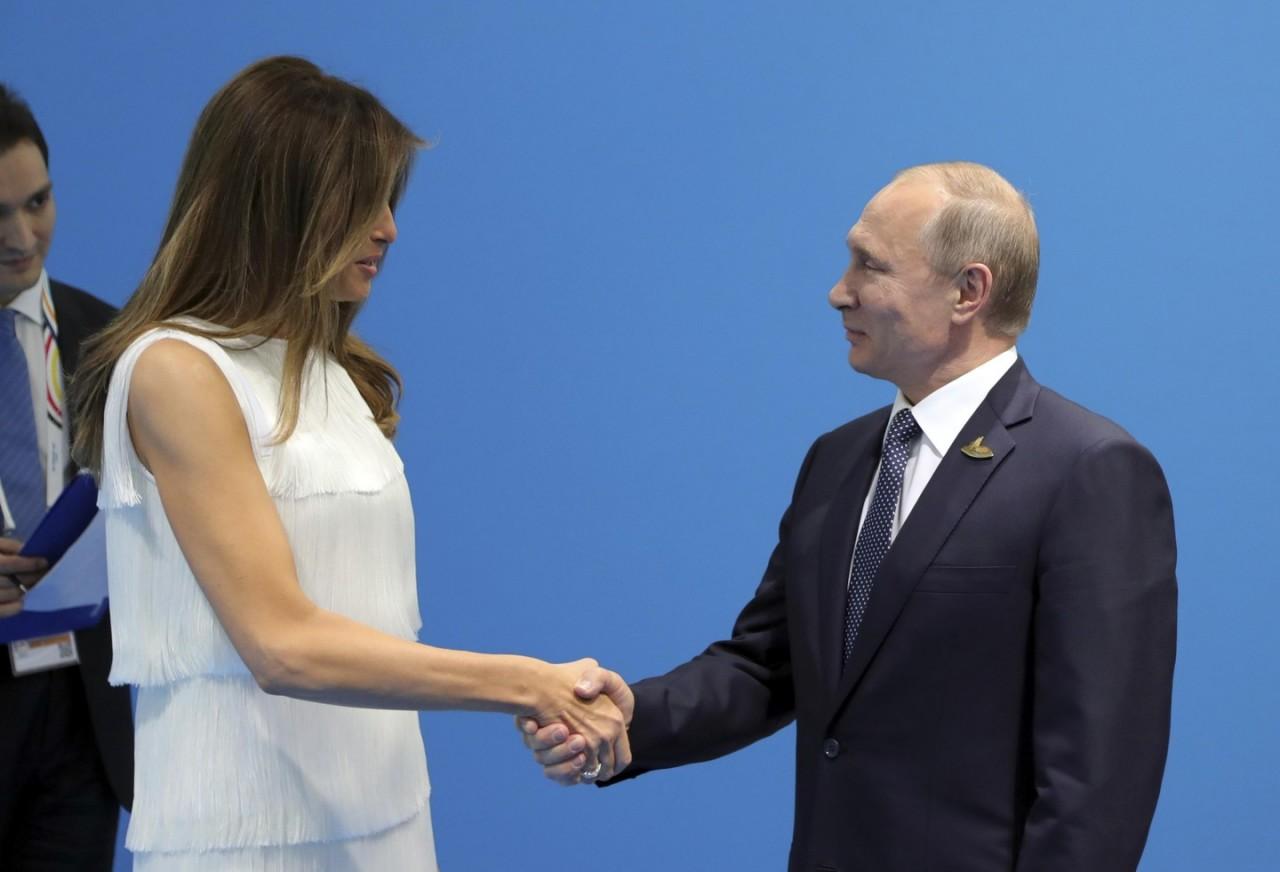 Физиономисты затихли: Владимир Путин познакомился с Меланьей Трамп