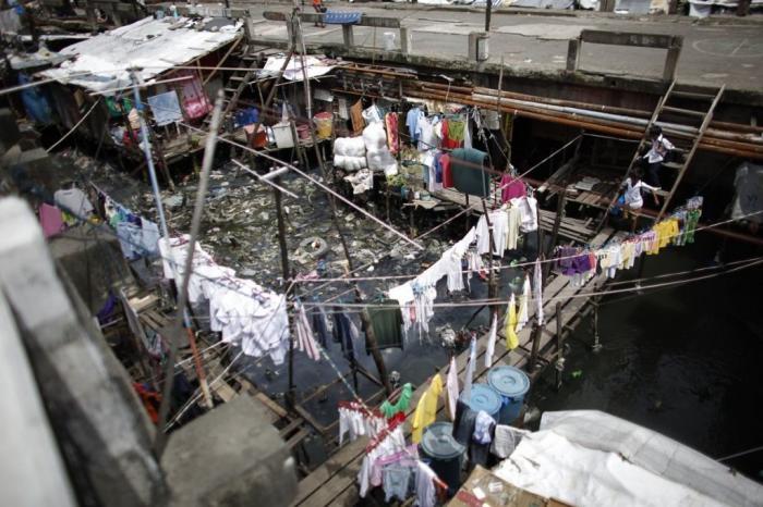 Как выглядит жизнь в самом густонаселенном городе мира (15 фото)