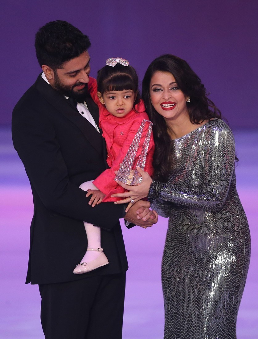 Former Miss World Aishwarya Rai, right speaks on stage with husband Abhishek Bachchan and daughter Aaradha, during the Miss World 2014 final, on stage at the Excel centre in east London, Sunday, Dec. 14, 2014. (Photo by Joel Ryan/Invision/AP)