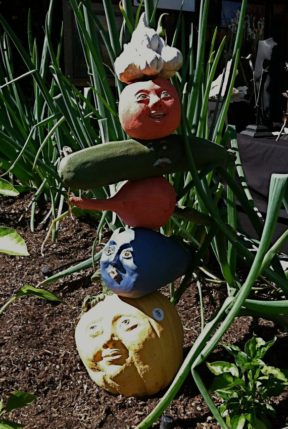 Veggie garden totems are made of high fired clay. Each vegetable (tomato, garlic, squash, eggplant, beet, corn, pumpkin, or cauliflower) is handmade and most have a face on either side for viewing from any angle. Designed to welcome friends to your veggie garden, they can also be put in a kitchen for the winter. <3