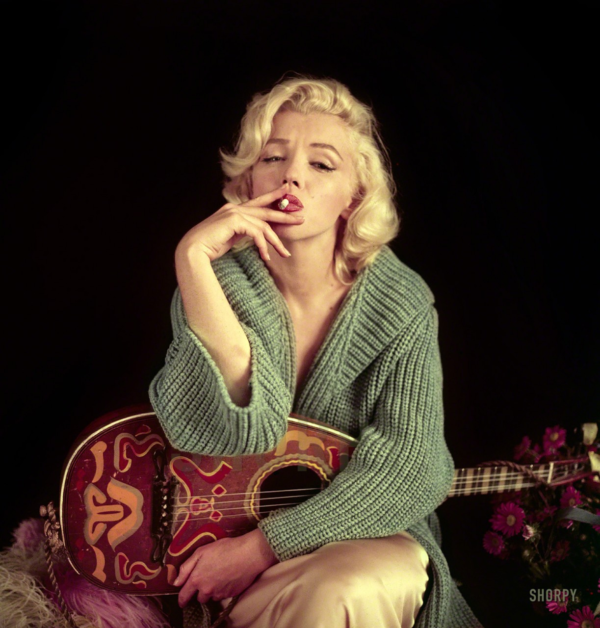 September 2, 1953. Los Angeles, California. Marilyn Monroe with mandolin.