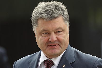 Порошенко в Берлине пообещал и дальше давить на Россию