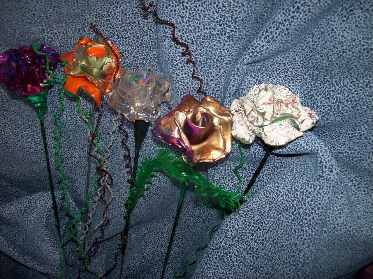 Сделать розу своими руками из дисков