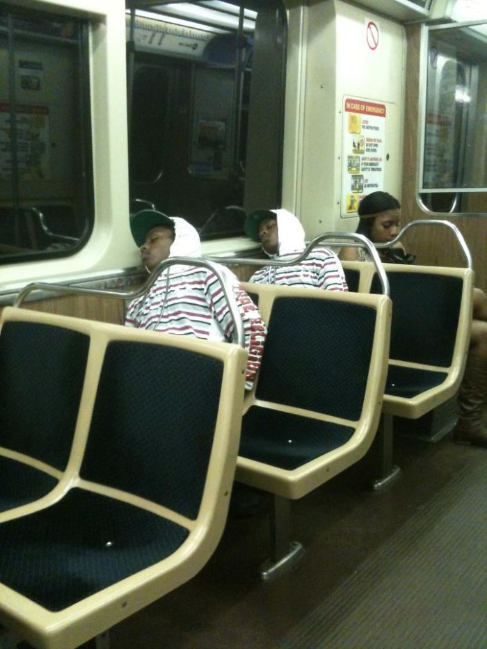 There Are Two Identical-Looking People Sleeping On The Subway