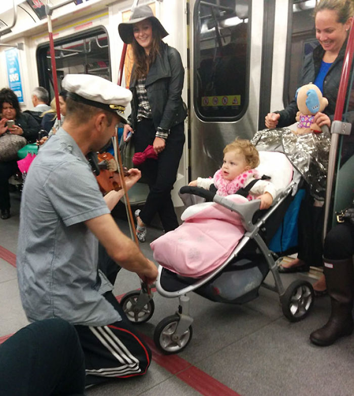 Man Spent His Subway Ride Playing His Violin For A Baby Because It Was Crying