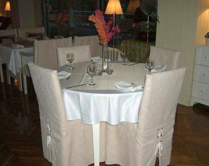 Покрой чехла для стула со спинкой будет зависеть от интерьера кухни в целом