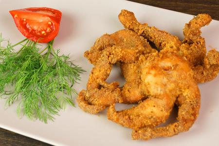 Фото к рецепту: Из куриной грудки  осьминожка