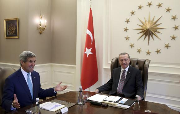 U.S. Secretary of State John Kerry (L) and Turkey's President Tayyip Erdogan meet in Ankara September 12, 2014. REUTERS/Kayhan Ozer/Presidential Press Office/Handout via Reuters