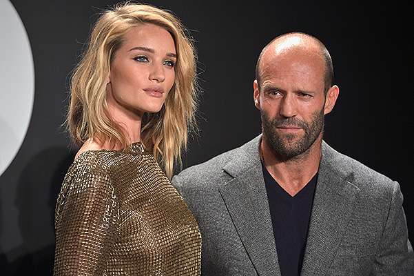LOS ANGELES, CA - FEBRUARY 20: Model Rosie Huntington-Whiteley (L), wearing TOM FORD, and actor Jason Statham attend the Tom Ford Autumn/Winter 2015 Womenswear Collection Presentation at Milk Studios in Los Angeles on February 20, 2015. (Photo by Charley Gallay/Getty Images for Tom Ford)