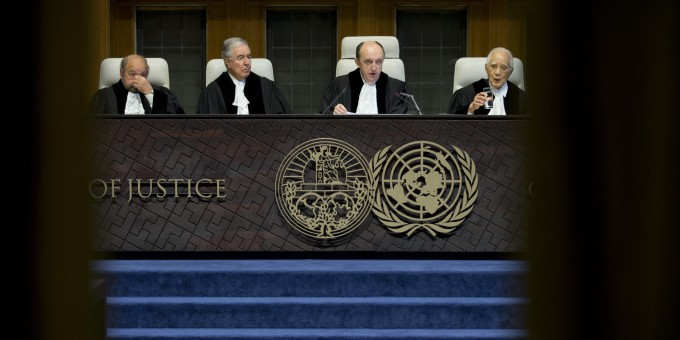 Presiding judge Peter Tomka, second right, of Slovakia starts reading the World Court's decision in The Hague, Netherlands Tuesday, Feb. 3, 2015 as the International Court of Justice, the United Nations' highest court, is ruling on whether Croatia and Serbia committed genocide during the wars sparked by the breakup off the former Yugoslavia in the 1990s. Croatia has accused Serbia of genocide early in the wars and Serbia in turn claims that Croat forces were responsible for genocide in a 1995 campaign to retake territory held by rebel Serbs. Other judges, from left, are; Ronny Abraham of France, Bernardo Sepulveda-Amor of Mexico, Tomka and Hisashi Owada of Japan. (AP Photo/Peter Dejong)