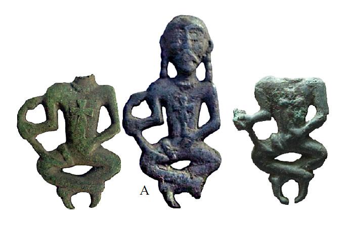 Фигурка (А) найденная в Черниговской обл. Место находки двух других фигурок автору не известны.