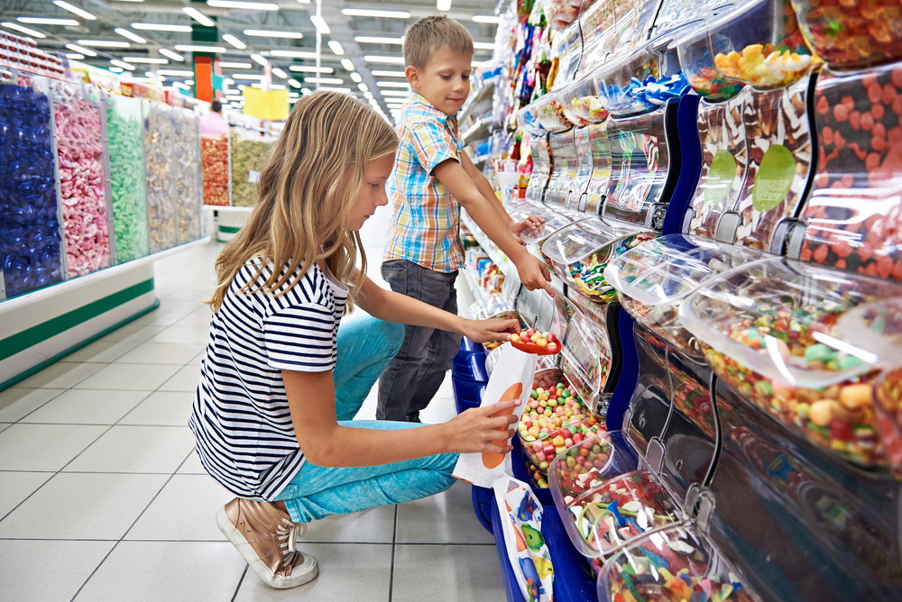 Children buy gummi candy