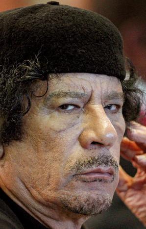 С замороженных счетов Каддаф…