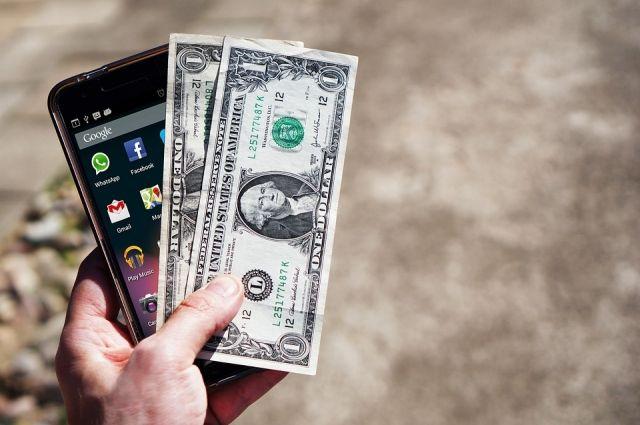 Курс доллара на торгах снизился до 66,35 рубля, евро - до 78 рублей