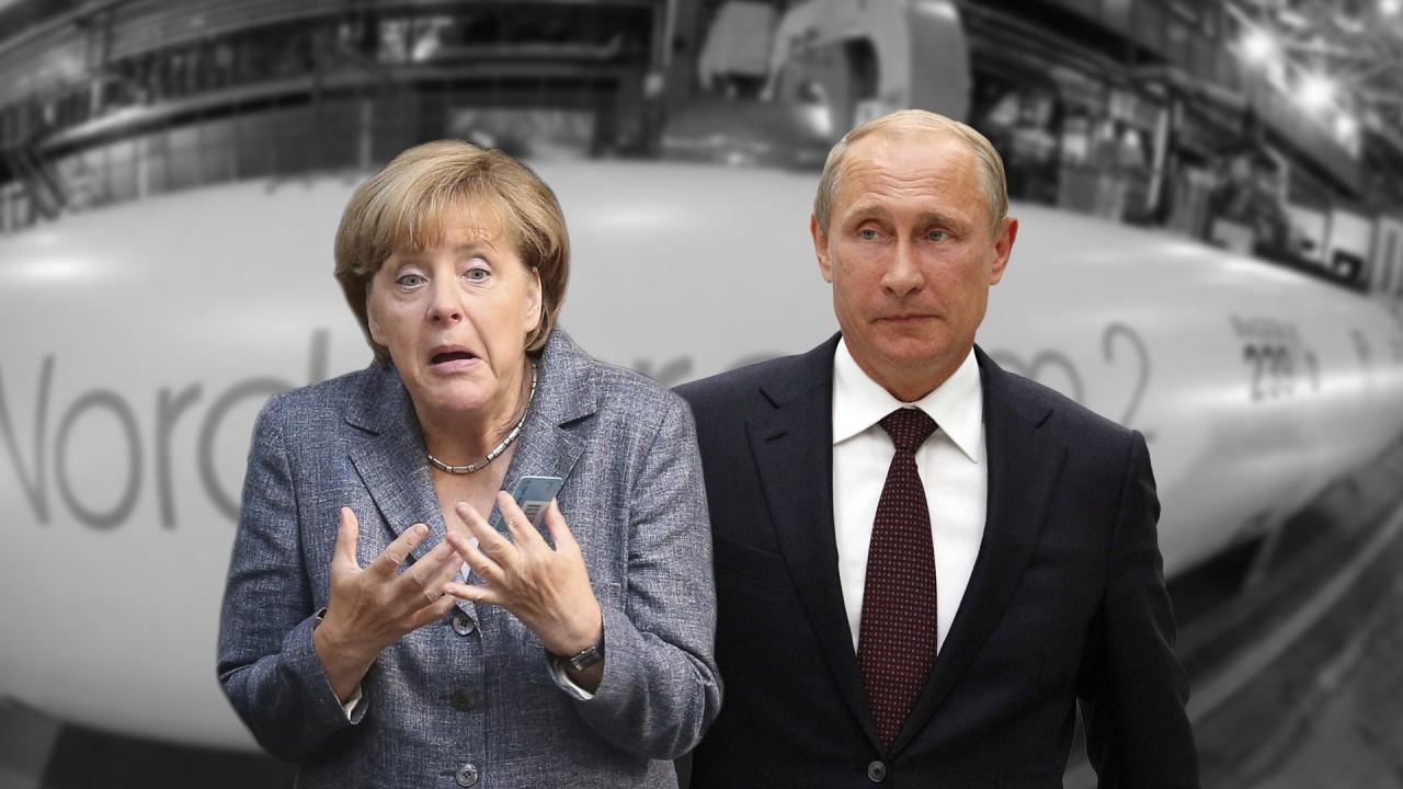 На двух стульях: Меркель реш…