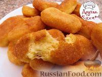 Фото к рецепту: Домашние сырные палочки