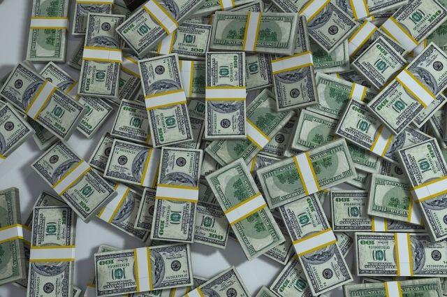 Курс доллара снизился до 66,6 рубля