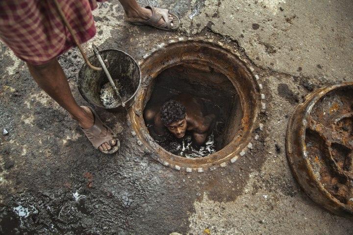 «Работник канализации», Суян Саркар CBRE городская фотография 2014 года