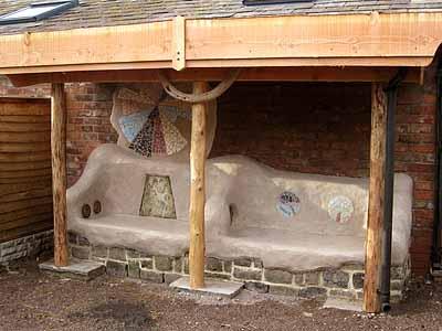 Оригинальные скамейки под навесом