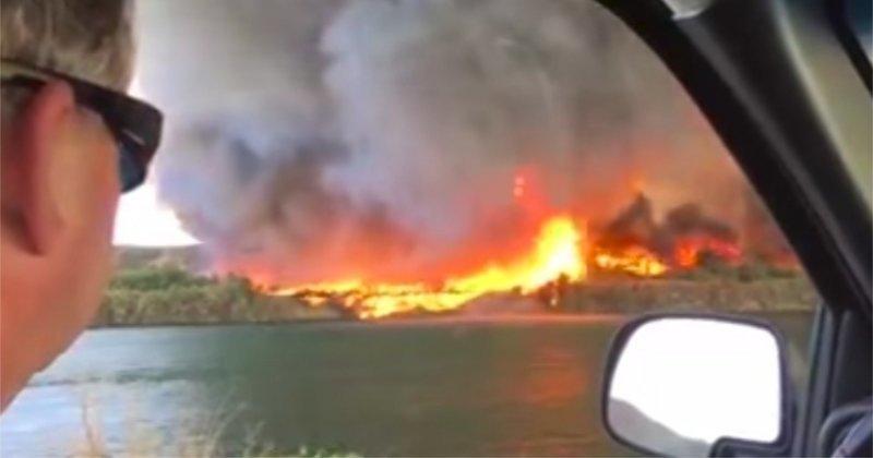 Семейная пара запечатлела на видео, как огненный вихрь превращается в водяной смерч