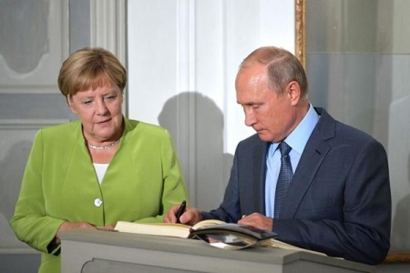 Путин и Меркель обсудили Сирию, Минские договоренности и убийство Захарченко