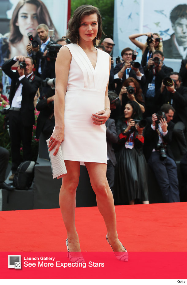 Milla Jovovich Debuts Growing Baby Bump At Venice Film Festival