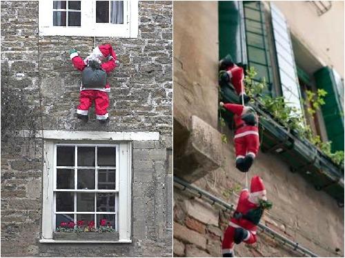 Санта клаус лезет в окно своими руками