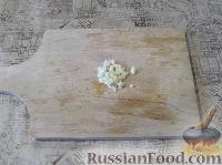 Фото приготовления рецепта: Пряный рис с изюмом и миндалем - шаг №2