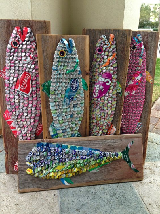 SOLD ART | The Moore Family Folk Art vintage soda can and bottle cap fish on 90 year old barn wood from Iowa by Folk Artist Alan Moore SOLD at The Blue Giraffe - WaterColor, Florida: