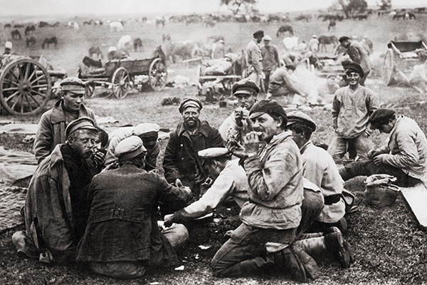 Russian troops at camp after crossing the German frontier into Prussia (now Poland) during World War I, circa 1915. (Photo by FPG/Hulton Archive/Getty Images)