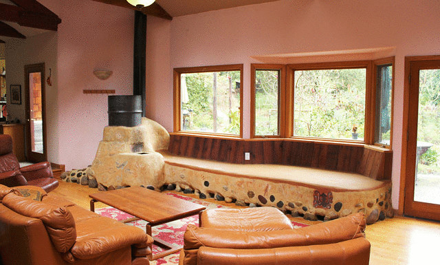 Реактивная дровяная печь с лежанкой