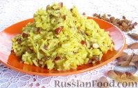 Фото приготовления рецепта: Пряный рис с изюмом и миндалем - шаг №12