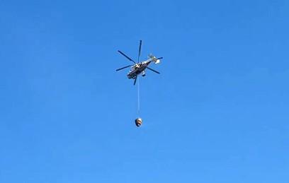 К тушению жилой многоэтажки в Королеве привлечены два вертолета