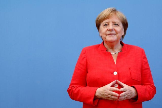 Меркель сказала, что радуется каждой встрече Путина и Трампа