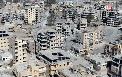 В пригороде Дамаска началась расчистка от завалов и баррикад