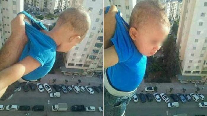 «1 000 лайков, или я его отпущу!» Алжирец поделился шокирующим фото ребенка за окном 15-го этажа.