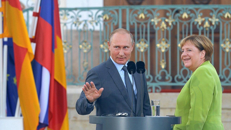 Путин обсудил с Меркель урегулирование в Сирии