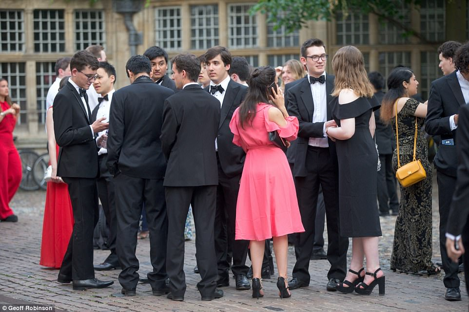 Long night ahead: The sold-out ball, which rolls on until 6am, is the largest event of the Cambridge student social calendar and some students queued for several hours to get into the party on Monday evening (pictured)