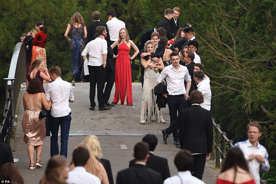 Those who were still standing at 6am gathered on a bridge as they marked the end of exams in boozy style this week