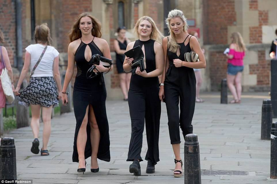 Ladies in black: Three friends who opted for matching monochrome ensembles were in good spirits ahead of the event