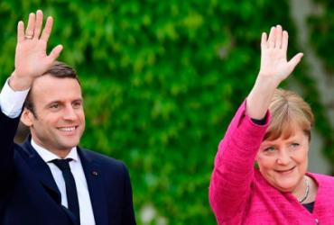 С какой стати Меркель и Макрон вдруг вспомнили про Донбасс?