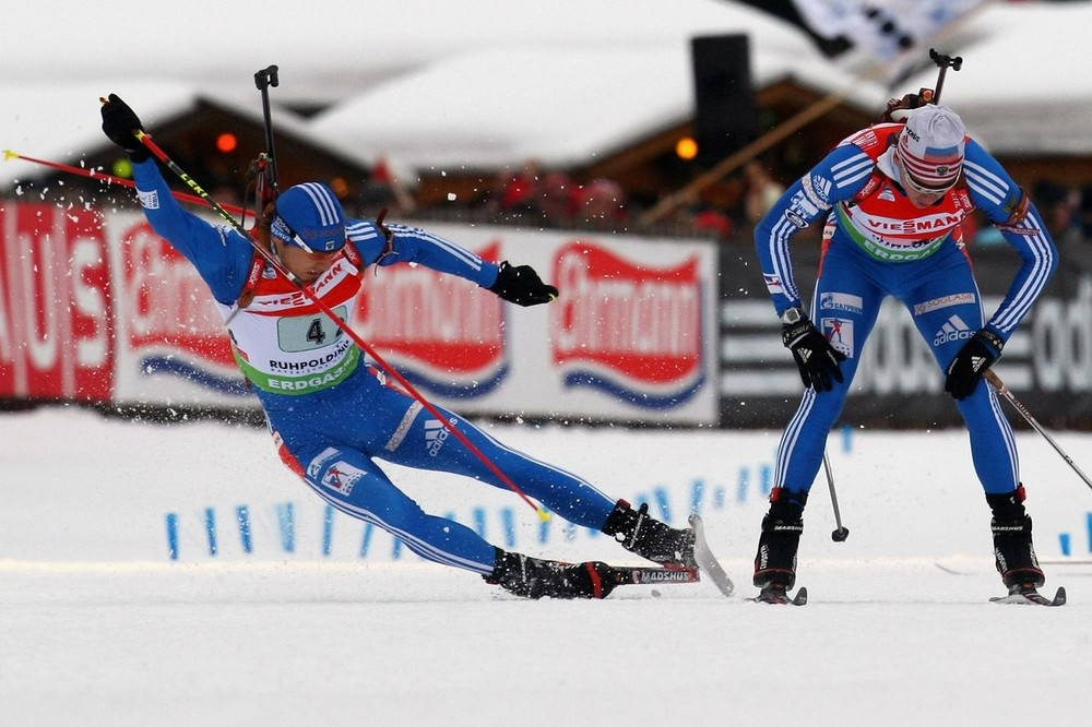 RUHPOLDING, GERMANY - JANUARY 17:  Anton Shipulin (L) of Russia crashes during the handover by his team mate Ivan Tcherezov (R) during the Men's 4 x 7,5km Relay in the e.on Ruhrgas IBU Biathlon World Cup on January 17, 2010 in Ruhpolding, Germany.  (Photo by Alexander Hassenstein/Bongarts/Getty Images)