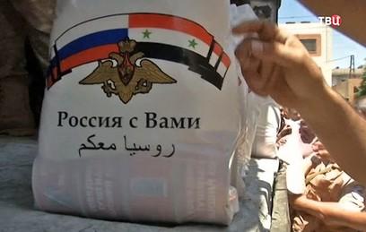 Российские военные доставили гумпомощь в Латакию