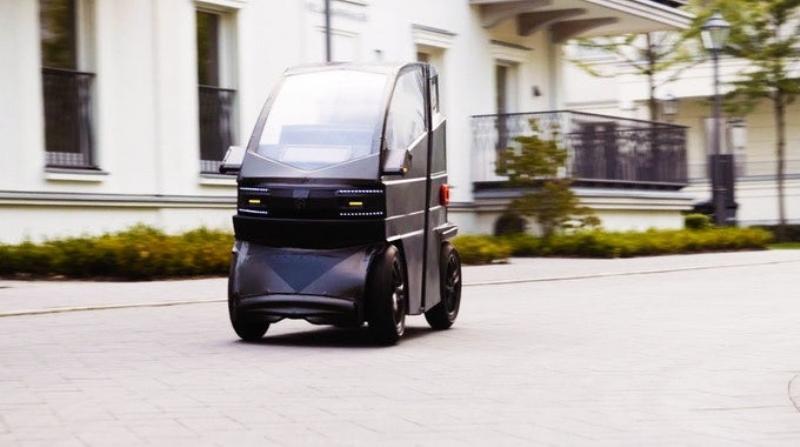 Крошечный электромобиль, который может растянуться, чтобы взять больше пассажиров.