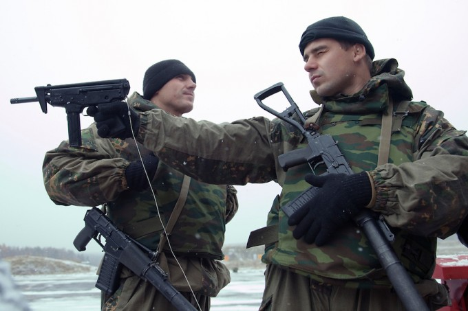 Krasnoarmeysk, Moscow Region, Russia, 29/10/2010. Members of Russian special forces inspect silenced weapons displayed by a dealer at training training exercise at a military base outside Moscow. The exercise was part of the Interpolitex 2010 state security exhibition.
