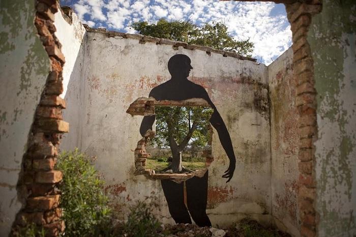 Человек и природа в уличном рисунке Дэвида де ла Мано, Сориано, Уругвай.